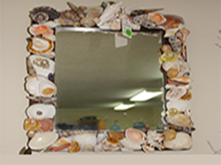 Bring Cape Cod home with this shell Mirror